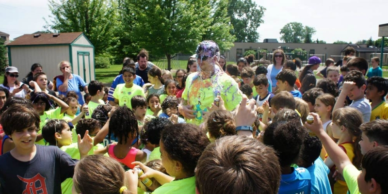 Students have a field day getting to silly string gym teacher